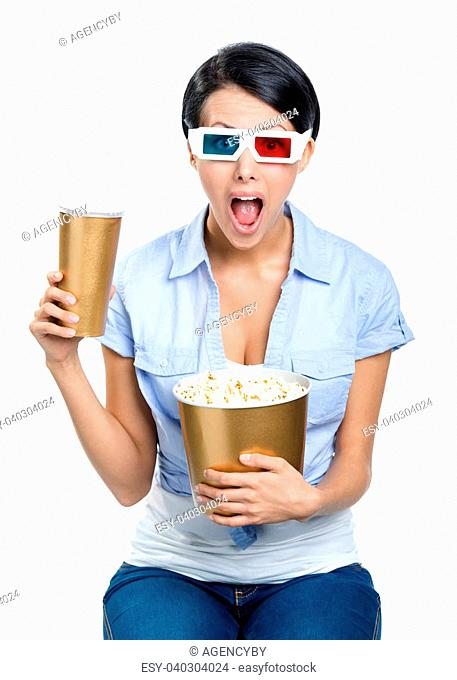 Girl in 3D glasses drinking beverage with popcorn and watching movie, isolated on white