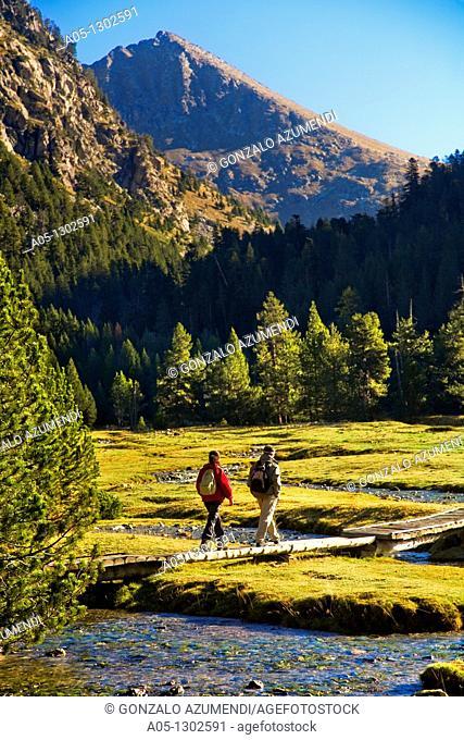 climbing landscape Estany Llong. Aigüestortes i Estany de Sant Maurici National Park, Pyrenees Mountains, Boi-Taull Valley  Alta Ribagorça Region