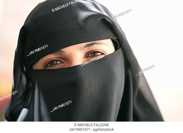 Woman wearing the Abbeya/Hijab, old Sanaa, Yemen