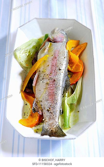Trout on a bed of vegetables