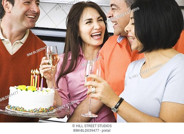 Middle-aged friends at birthday party