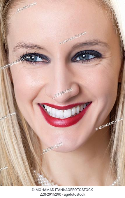 Beautiful blond woman make up looking away smiling