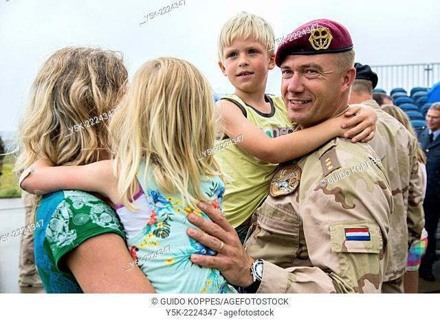 Eindhoven Airbase, Eindhoven, Netherlands. Airforce military employee welcomed home by his wife and two children after being deployed to Afghanistan for six...