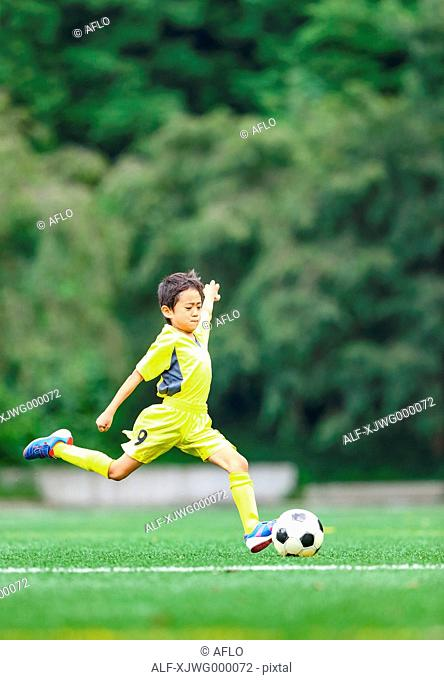 Japanese kid playing soccer