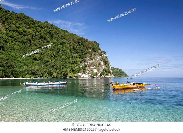 Indonesia, Lesser Sunda Islands, Alor Island, Batu Putih, fishing boat front of the Batu Putih beach (the white stone)