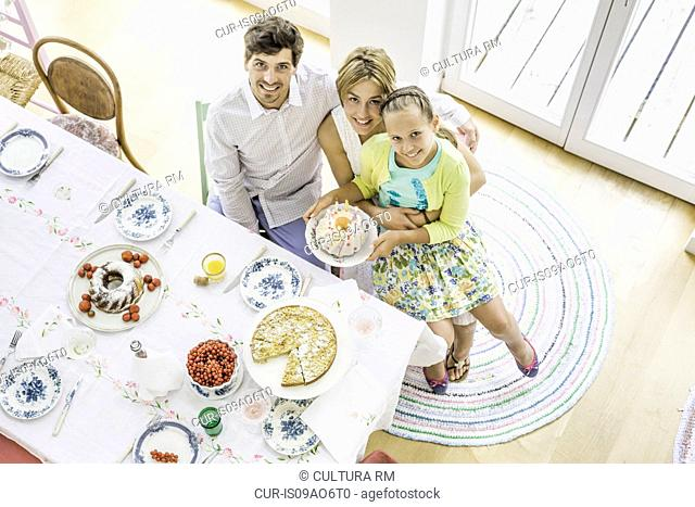 Overhead view of girl and parents at birthday party