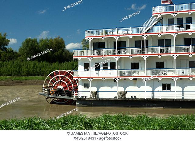 An historic Mississippi River boat is driven by a steam-powered paddle mounted aft