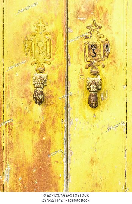 historic doorknockers in the form of hands, lagos, algarve, portugal