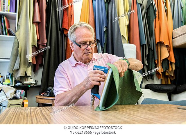 Tilburg, Netherlands. The 72 year old 'Boy' still works as an independent upholsterer in his own workshop, down town Tilburg