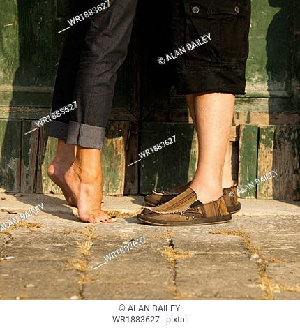 Italy, Venice, Couple standing by wooden door in old town