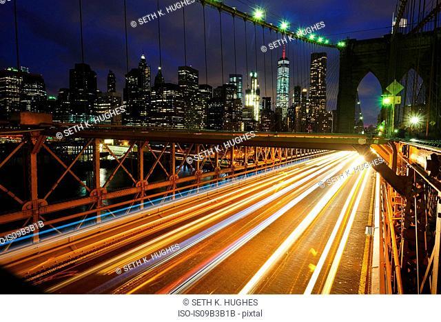 Light trails on Brooklyn bridge, New York, USA