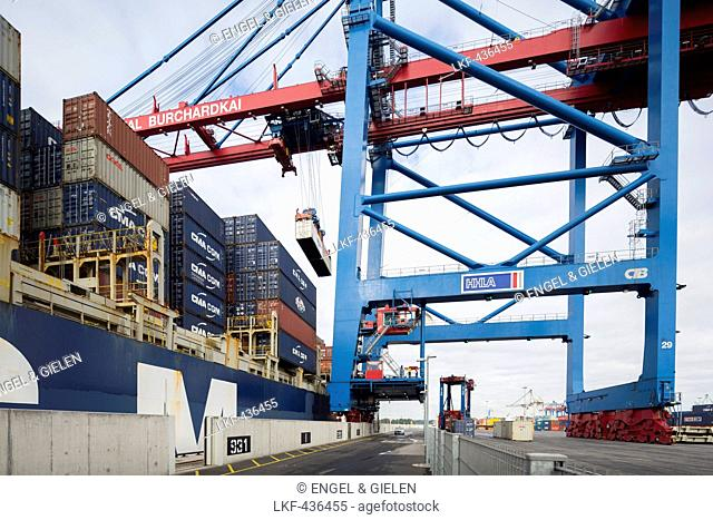 Container ship loading and unloading at the container terminal Burchardkai, Hamburg, Germany