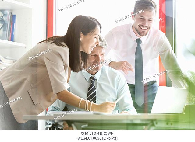 Business people in office having a meeting