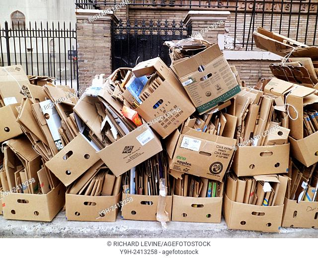 Cardboard trash bundled for pick up and recycling in New York