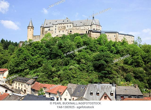 Vianden, Grand Duchy of Luxembourg, Europe  View of the hilltop castle overlooking the village houses below