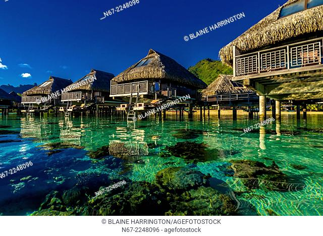 View of the overwater bungalows in the lagoon from inside the reef, Hilton Moorea Lagoon Resort, island of Moorea, Society Islands, French Polynesia