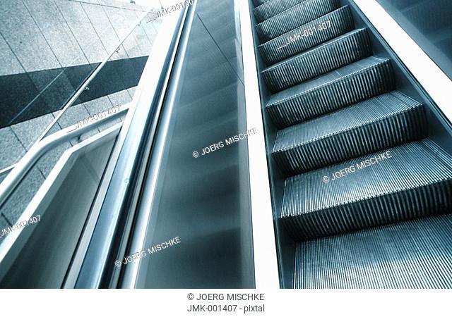 An escalator, moving