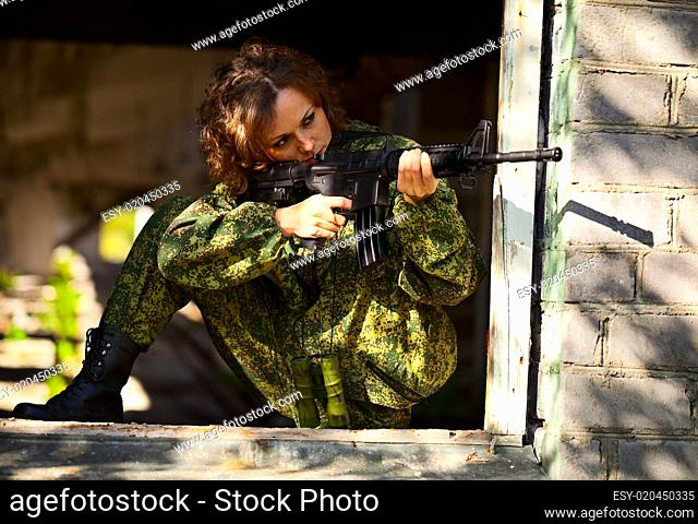Young woman with a rifle