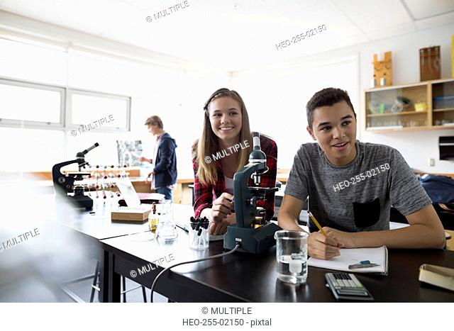 High school students at microscope science laboratory classroom