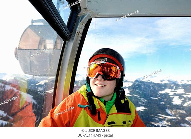 Teenage boy in cable car on skiing holiday, Tirol, Austria, Europe