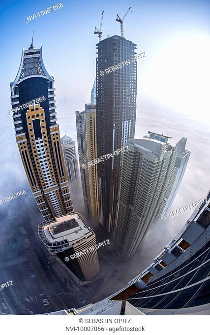 Tallest Block on the Planet in Marina in morning mist at sunrise, fish eye, New Dubai, UAE