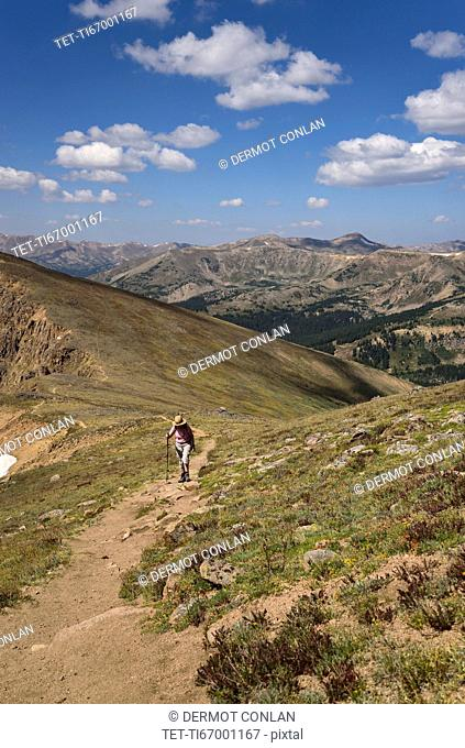 Woman hiking on Mount Flora in Colorado