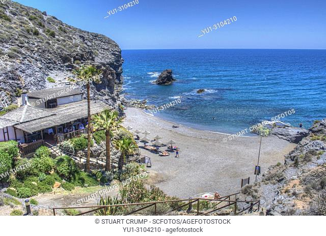 HDR image of the Beach, La Cala Restaurant and cove at Calle del Barco at La Manga Golf Resort in Murcia Spain