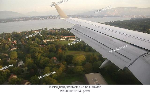 Aerial footage of an aeroplane flying above Zurich, Switzerland