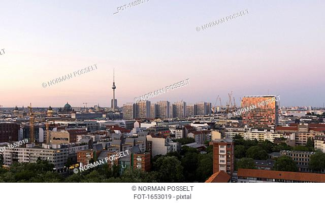 Distant view of Fernsehturm against sky during sunset, Berlin, Germany