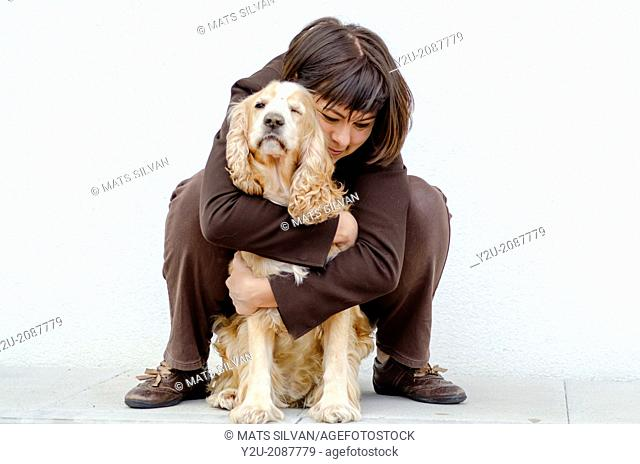 Woman hugging her dog