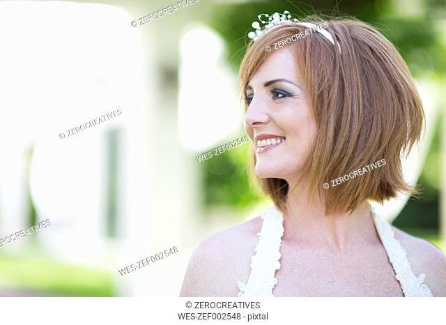 Smiling bride looking away