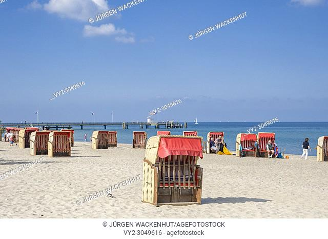 Beach and canopied wicker beach chair, Dahme, Baltic Sea, Schleswig-Holstein, Germany, Europe
