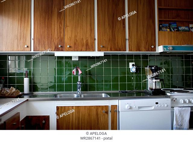 Wooden cabinets in domestic kitchen