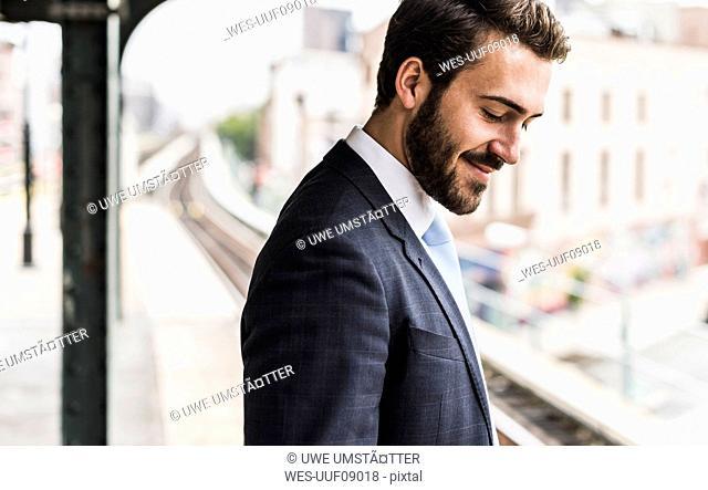 Young businessman waiting at metro station platform