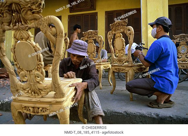 Two carpenters working in a workshop, Vietnam
