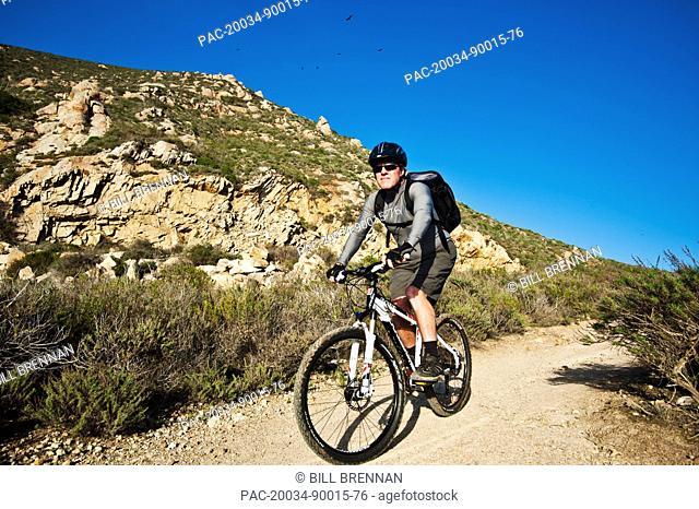 California, Morro Bay, Man biking on Quarry Trail