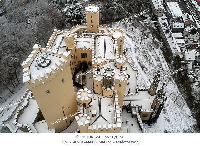 31 January 2019, Rhineland-Palatinate, Koblenz: The snow-covered Stolzenfels Castle is surrounded by a landscape park that was once designed by Peter-Josef...