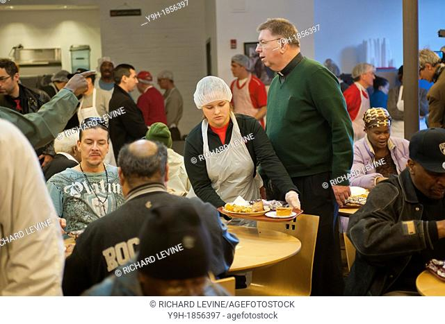 Volunteers and staff of St John's Bread and Life, prepare and serve a Thanksgiving dinner for the neediest at their facilities in the Bedford-Stuyvesant...