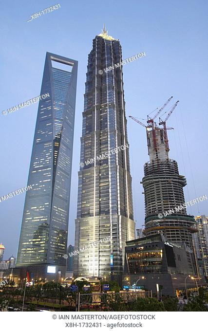 Three skyscrapers with Shanghai Tower on the right under construction in Lujiazui financial district in Pudong Shanghai China