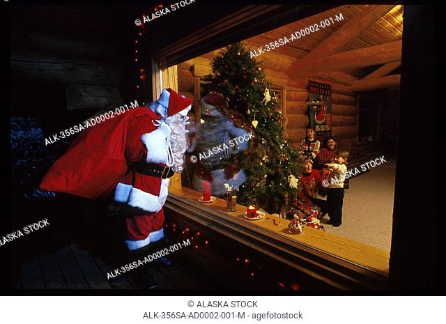 Santa Claus Looking in Cabin Window at Family Girdwood Ak Christmas Tree Southcentral