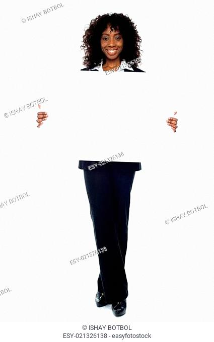 Corporate woman displaying white ad board