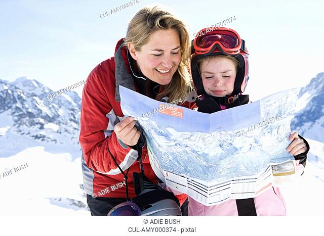 Mother and daughter reading piste map