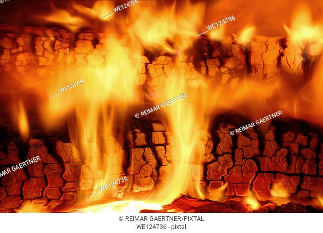 Flames from burning wood logs in a high efficiency fireplace insert