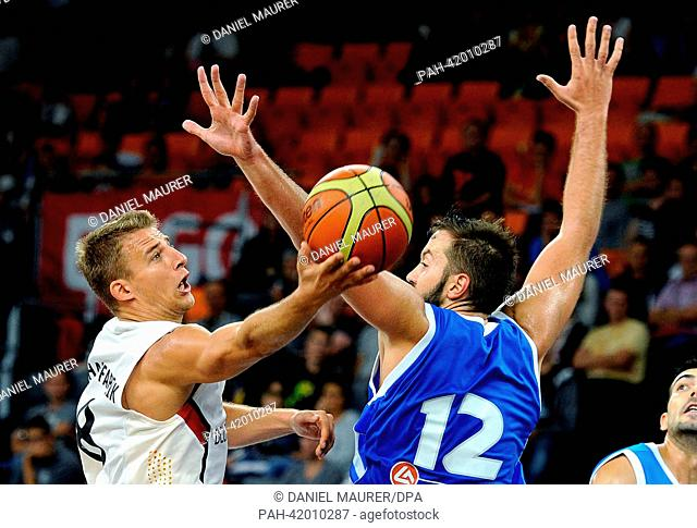 Germany's Heiko Schaffartzik (L) vies for the ball with Greece's Ian Vougioukas during the Basketball Supercup match between Germany and Greece at ratiopharm...