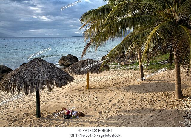 FINE SANDY BEACH WITH PALM TREES SITUATED BETWEEN THE VILLAGE OF LA BOCA AND ACON BEACH TO THE SOUTH OF THE TOWN OF TRINIDAD, CUBA, THE CARIBBEAN