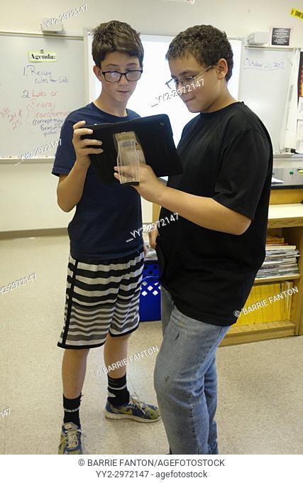 8th Grade Boys Using iPad in Classroom, Wellsville, New York, USA