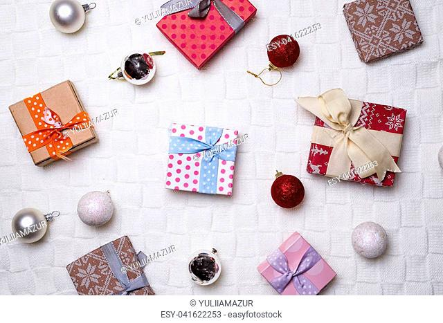 Christmas background with decorations. New Year . Gifts in handicraft paper and many other Christmas festive decorations. Horizontal view, top view