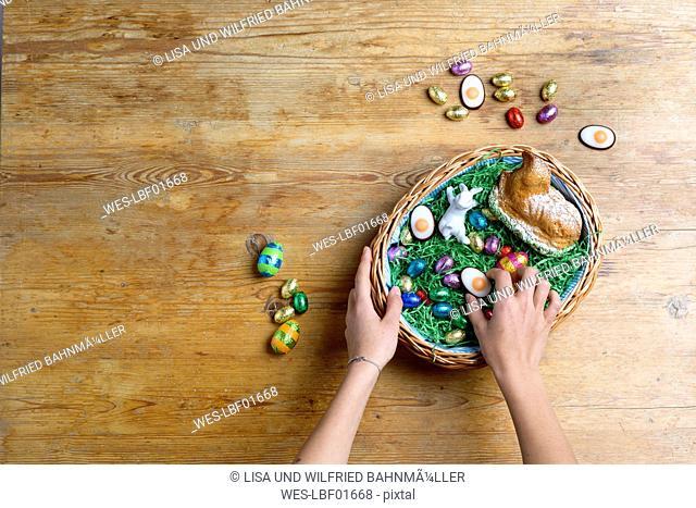 Hands filling Easter nest