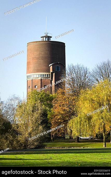 Old water tower and trees in autumn