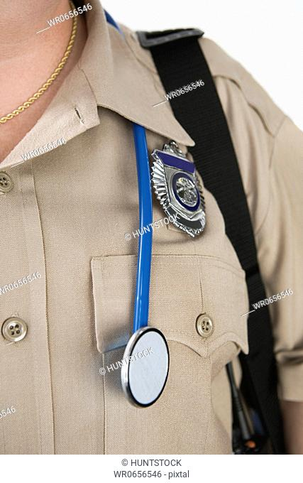 View of a Emergency Medical Service officer wearing a stethoscope